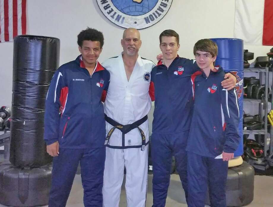 Joined by instructor Robert Webre at their Cypress Martial Arts & Fitness gym, CFISD graduates (L-R) Mason Armstrong, Logan Thibodeaux and Cypress Ranch student Jarrett Kinsey prepare for the ITF World Championships July 26-31 in Brighton, England.