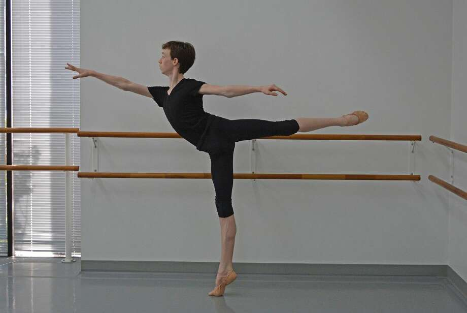 Finn Adams, an incoming sophomore at Cypress Woods High School, holds an arabesque pose during a rehearsal at the Houston Repertoire Ballet. Adams is one of five annual scholarship winners to attend the Central Pennsylvania Youth Ballet. (Photo by Julie Hacker)