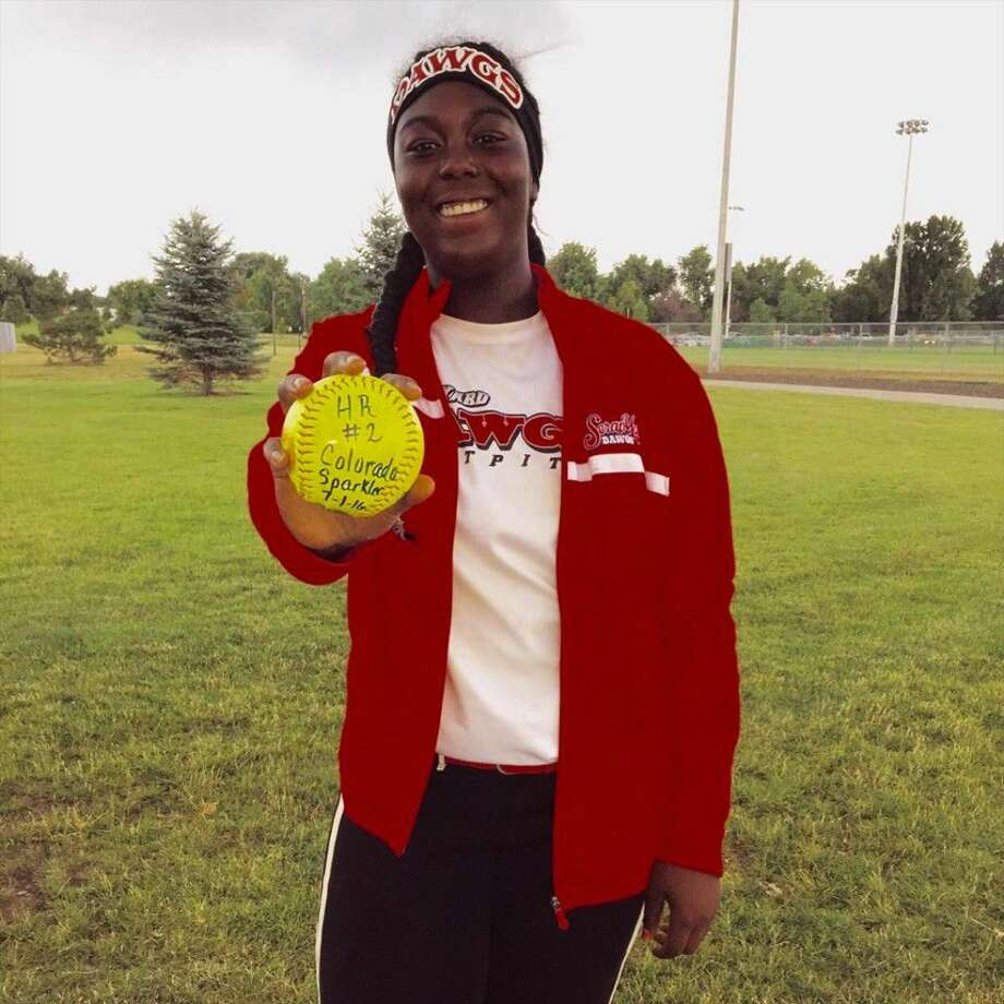 Sydnee Hebert poses here with the second of her three home run ball hit at the Triple Crown Colorado Fireworks Sparkler 2016 Tournament, June 27-July 2. Photo: Submitted Image