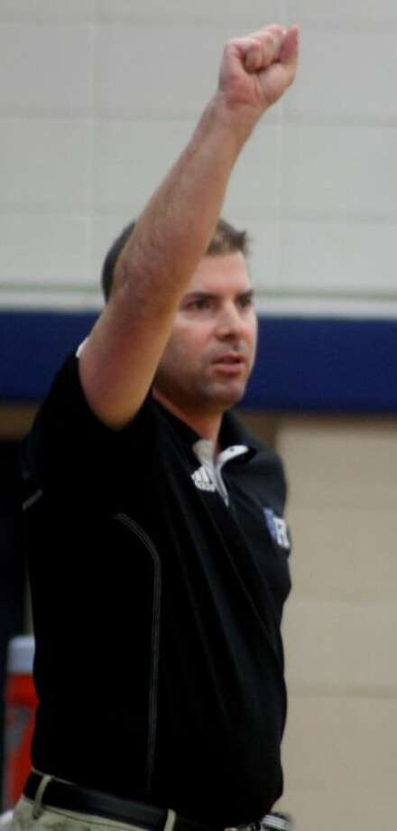 Sam Rayburn head coach Jeremy Mills signals a play during the South Houston game. Friday night, it'll be another edition of the Rayburn-Pasadena rivalry at the Texans Gym. Photo: Robert Avery