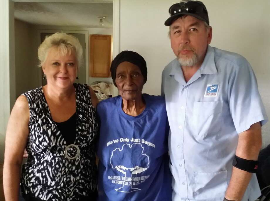 Sallie Lewis, 92, of Cleveland, was surprised by two Good Samaritans Tuesday, July 12, when they showed up at her home with a new window air conditioning unit. Her mailman, Chris Bissell (right), noticed how hot Lewis's home was during a recent mail delivery and shared the information with a friend, Dianne Brady, who offered to buy the AC unit for Lewis. Photo: Vanesa Brashier