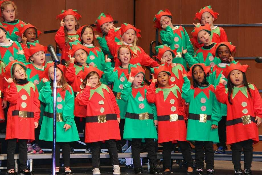 """These Kindergartners from The John Cooper School are thinking about the toys and candy they would get as an elf, singing """"I Want to be an Elf."""""""