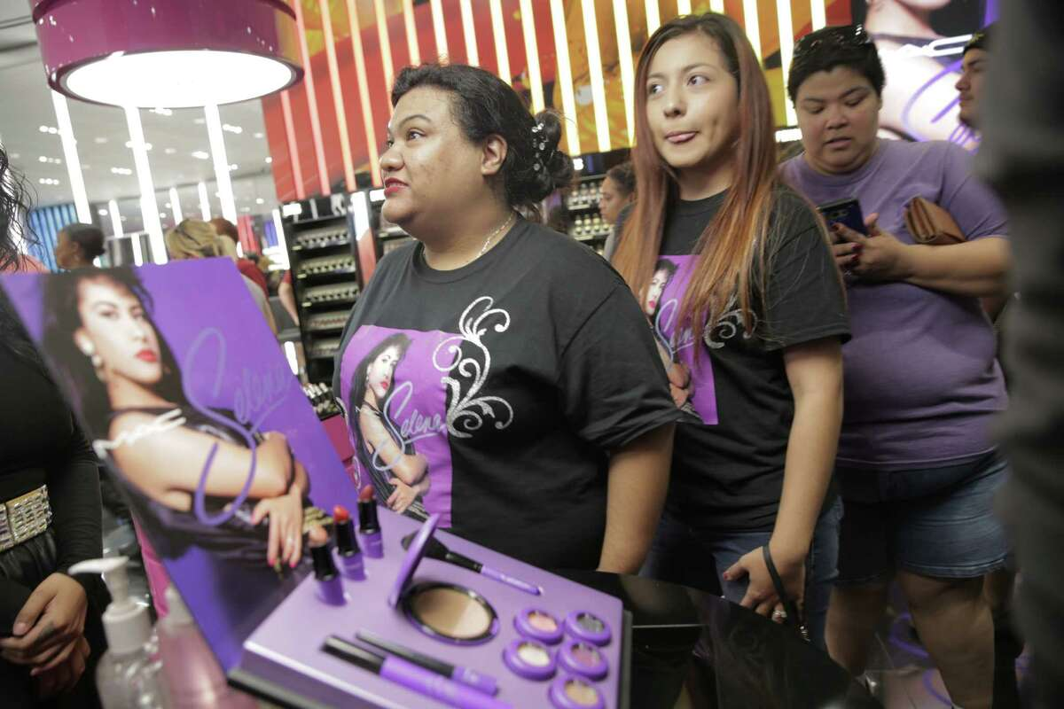 A shoppers check out the display for MAC's Selena Collection at the Galleria on Thursday, Oct. 6, 2016, in Houston. Stores were expecting to sell-out this morning.