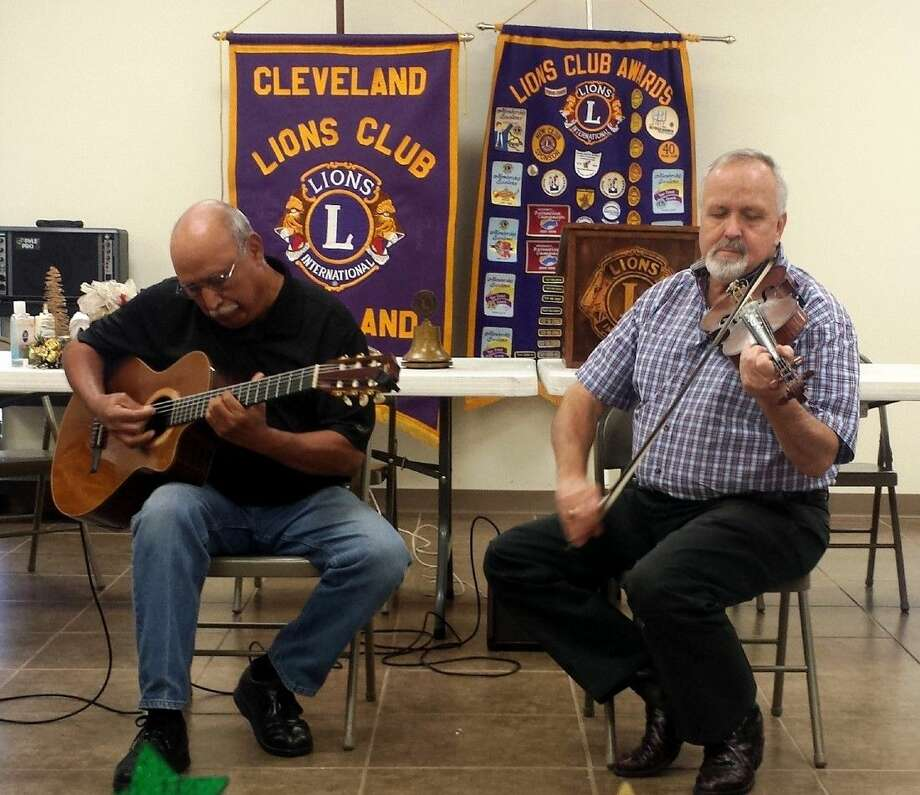 Liberty County Judge Jay Knight, accompanied by longtime friend and guitar player Israel Ramos, played a variety of classics on his fiddle for members of the Cleveland Lions Club. Photo: Stephanie Buckner