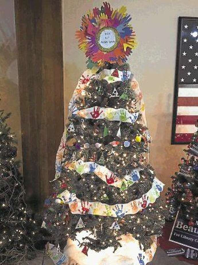 "Stephen F. Austin's kindergarten and first grade entered a tree titled ""Artistic hands"" in the Dayton Community Center's Christmas tree this year and won the trophy for Best Creativity. Photo: Casey Stinnett"