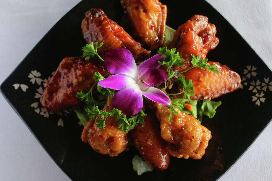 The housemade Wild Goji sauce balances sweet, sour and hot tastes to create a very good wing sauce. Photo: John Davenport /San Antonio Express-News / ©San Antonio Express-News/John Davenport