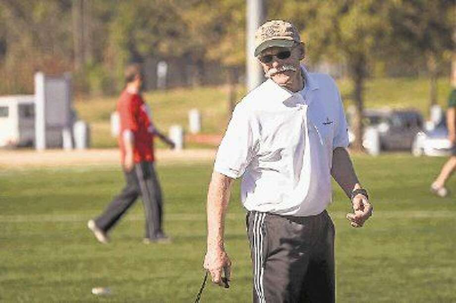 The Woodlands assistant coach Gordon Schoeller referees during a The Woodlands High School soccer team alumni match at Bear Branch.