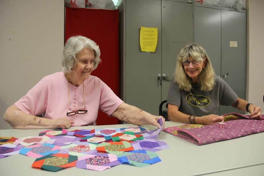 Charlotte Walker, left, instructs a quilting student. Walker, 87, has taught needlework and stitching classes since 1984 at College of the Mainland.