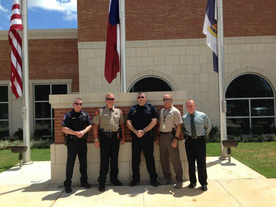Montgomery County Precinct 1 Constable Sgt. Jarrett Rhodes, Montgomery County Sheriff-elect Rand Henderson, Precinct 1 Constable Lt. Dan Lafferty, MCSO Capt. Bruce Zenor and Conroe Police Deputy Chief Jeff Christy gather at the Conroe Police Department's new building Monday for a flag ceremony honoring first responders.