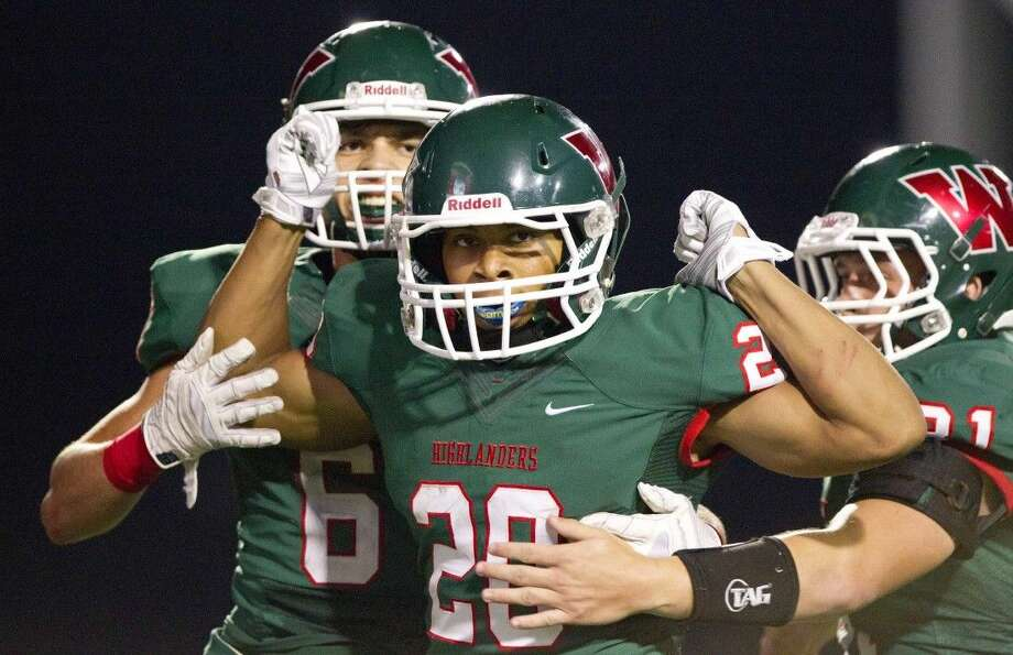 The Woodlands' Antoine Winfield Jr. (20) celebrates with teammates after scoring a touchdown against La Porte. Winfield is The Courier's choice for Montgomery County Player of the Year.