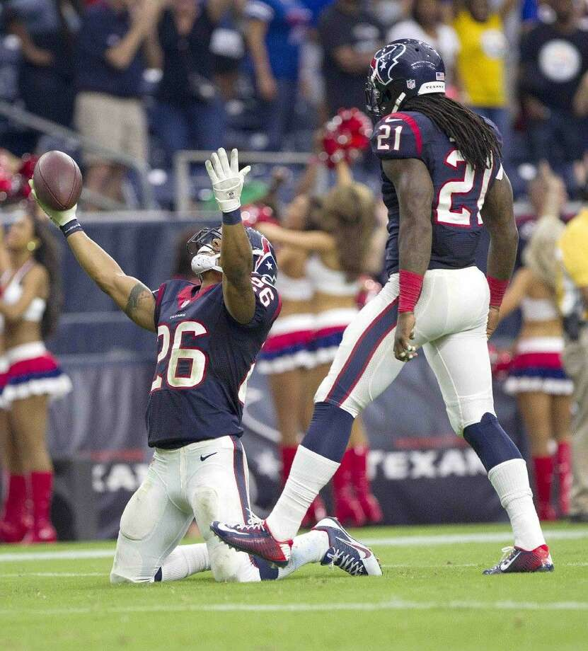 Houston Texans corner back Darryl Morris (26) celebrates after intercepting a pass by Buffalo Bills quarterback EJ Manuel late in the fourth quarter of an NFL football game Sunday. The Houston Texans defeated the Buffalo Bills 23-17.