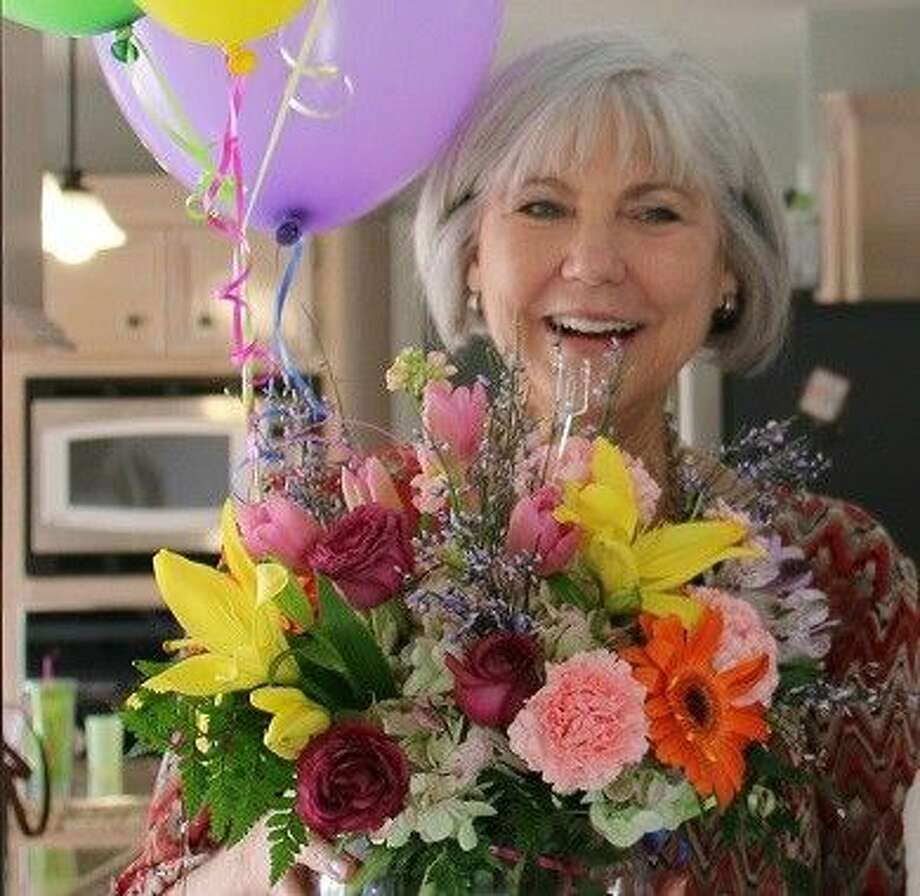 "Kathryn ""Kit"" Pfeiffer is the winner of the 2015 Citizen of the Year. She was recently surprised by members of the GTACC with balloons and flowers at her home."