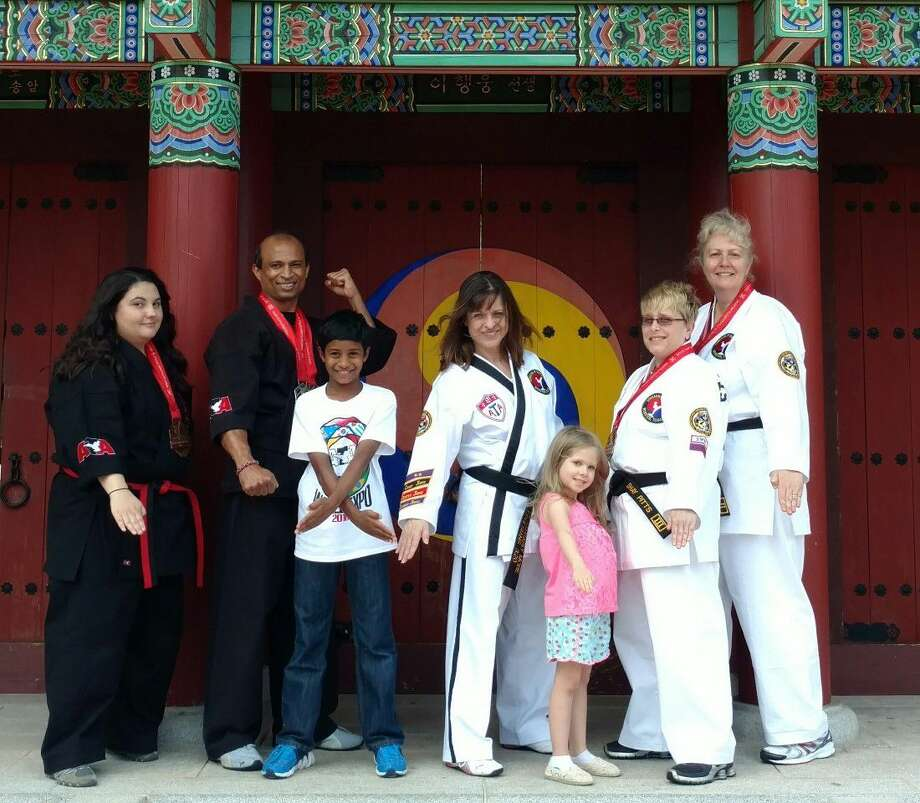 Members of Davenport's ATA Martial Arts in Webster brought home 26 medals from the World Championships. Photo: Submitted Photo