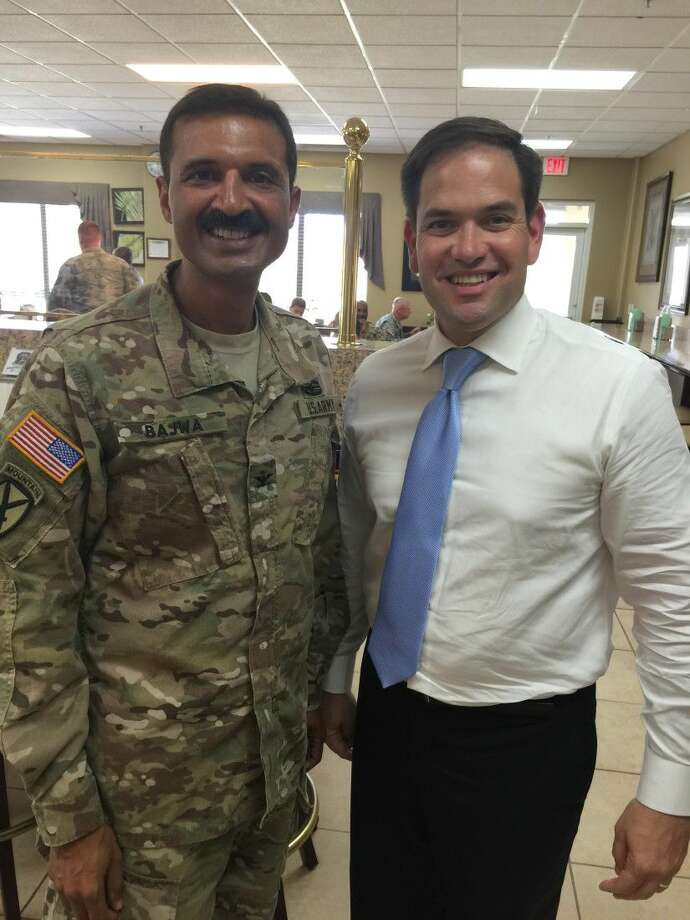 "Sugar Land resident Kulvinder ""Vinni"" Bajwa with Senator Marco Rubio. During his time away from the office, Bajwa, an assistant professor and member of Minimally Invasive Surgeons of Texas (MIST) at McGovern Medical School at UTHealth, serves as a colonel in the U.S. Army Reserves."