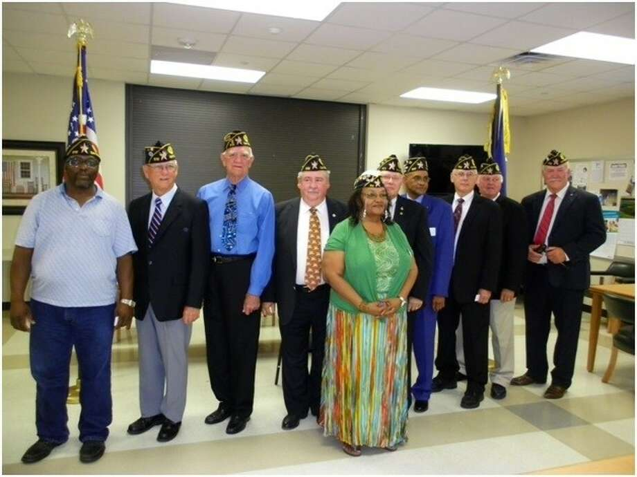The American Legion Dayton Memorial Post 512 elected new officers, who were sworn in on July 22 at an installation ceremony at the Dayton Community Center. Pictured are (back row, left to right) Gregory Cook — Sergeant-at-Arms, Lee Krigar — Past Commander, Charles Grabein — Service Officer, Ken Morrison — Judge Advocate, Jerry Killion — Adjutant, Jerry Tatman, Mike Key — 1st Vice Commander, Jim Sterling — Historian, and Ron Heinen — New Post Commander; (front row) Glenda Simon — District 2 Commander. Not pictured are Chris McCarty - finance officer, Damon Hilsmeier - Chaplain and Wilbert Winkelmann - 2nd Vice Commander. Photo: Submitted Photo