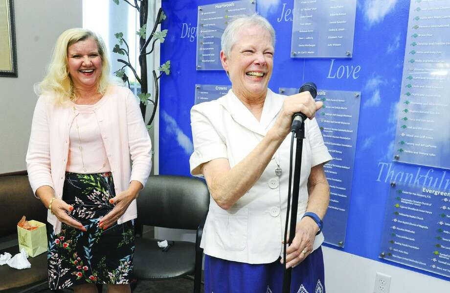 New TOMAGWA Director Lee Ann Kroon laughs as former TOMAGWA Director Judy Deyo speaks to those gathered at a reception celebrating her retirement from TOMAGWA on July 21. Photo: Tony Gaines