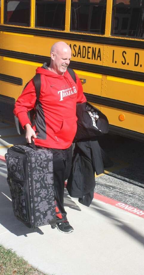 With suitcase and pillow, South Houston High School varsity boys basketball coach Patrick McCoy is all ready for his team's trip to Waco Monday afternoon. The red-hot Trojans, off to a 4-1 start in district, could see as many as four games in the Waco Tournament before returning home and the last 11 contests of district. Photo: Robert Avery