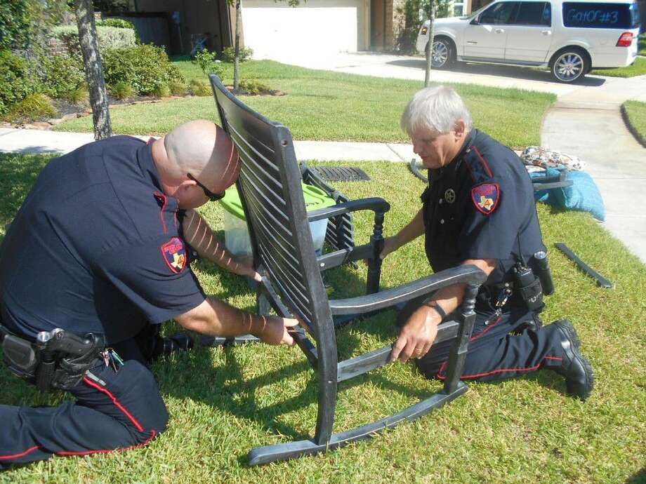 Deputies reassemble some patio furniture reportedly stolen from the porch of an area resident. Photo: Submitted Photo
