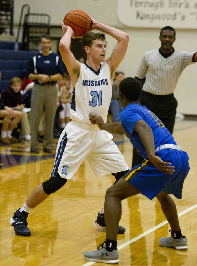 Kingwood guard Mitchell Clouse looks to pass during a basketball game at the Insperity Holiday Classic at Kingwood High School Monday, Dec. 28, 2015. Go to HCNpics.com to purchase this image and view more photos from the tournament. Photo: Jason Fochtman