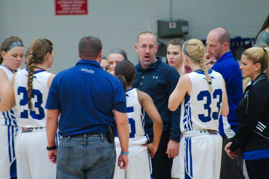 Friendswood head girls' basketball coach Daron Scott tries to keep his team on track for a 24-6A crown when the Lady Mustangs host Brazoswood next Tuesday. Photo: KIRK SIDES
