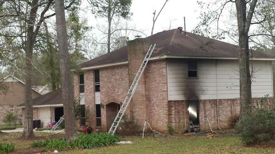 A Roman Forest family's house was damaged by fire and smoke after investigators believe a natural Christmas tree started a fire.