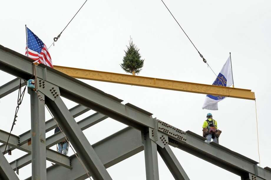 The Topping Out ceremony at the Smart Financial Centre featured the hoisting of a ceremonial steel beam, traditionally marking maximum building height.The construction milestone occurred Dec. 1 in Sugar Land. Placement of an evergreen tree and flags on the beam is customary. Photo: Craig Moseley