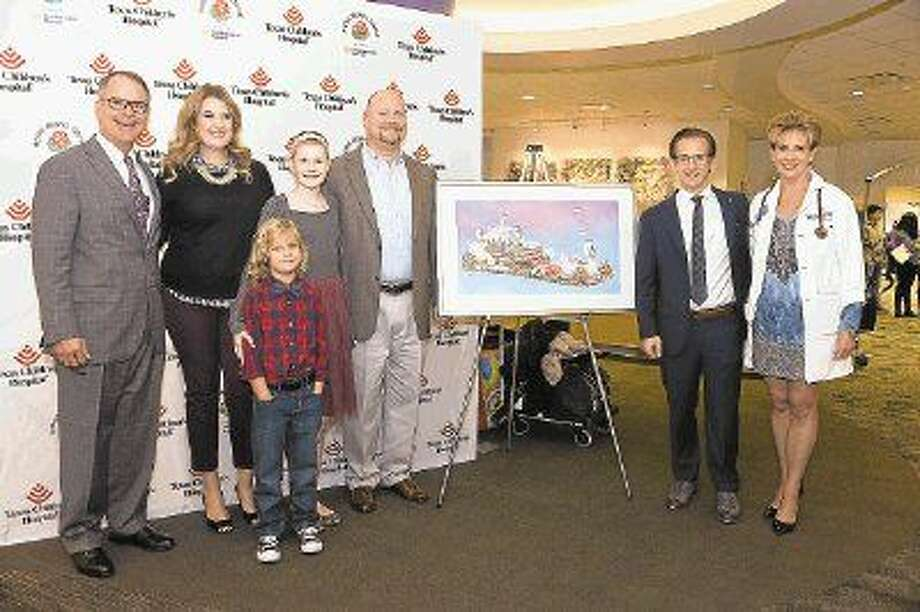 On Dec. 2, Northwestern Mutual unveiled its float design for the 127th Rose Parade. Titled 'Dancing into Adventure,' the design was inspired by Peyton Richardson's winning video, selected from many submitted across the country. Pictured (l to r) are Jeff Reeter, Managing Partner, Northwestern Mutual Houston; the Richardson family of Sugar Land (mom Carrie, daughter Peyton, brother Major, and dad Roger); J.C. Woods, Director of Marketing, Northwestern Mutual Houston; and Dr. ZoAnn Dreyer, Co-director of the Long Term Survivor Program at Texas Children's Hospital.