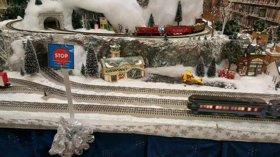 The 12-foot by 5-foot train display features moving trains, a village scene and also serves as an I-Spy game for children and teenagers.