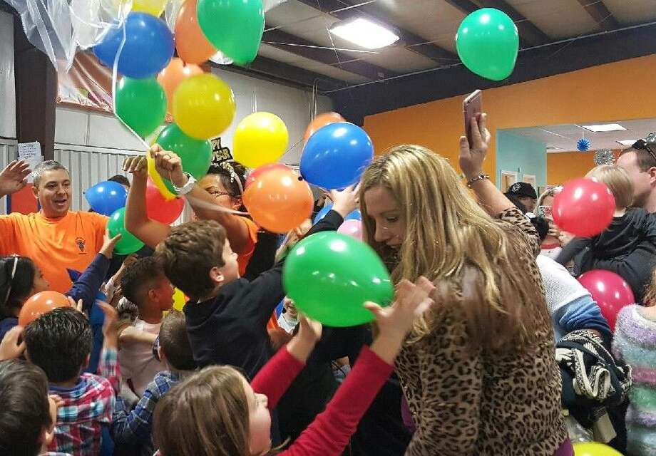 Balloons rain down on cheering children at the Noon Year's Eve party at JC Sports in Atascocita on Thursday, Dec. 31.