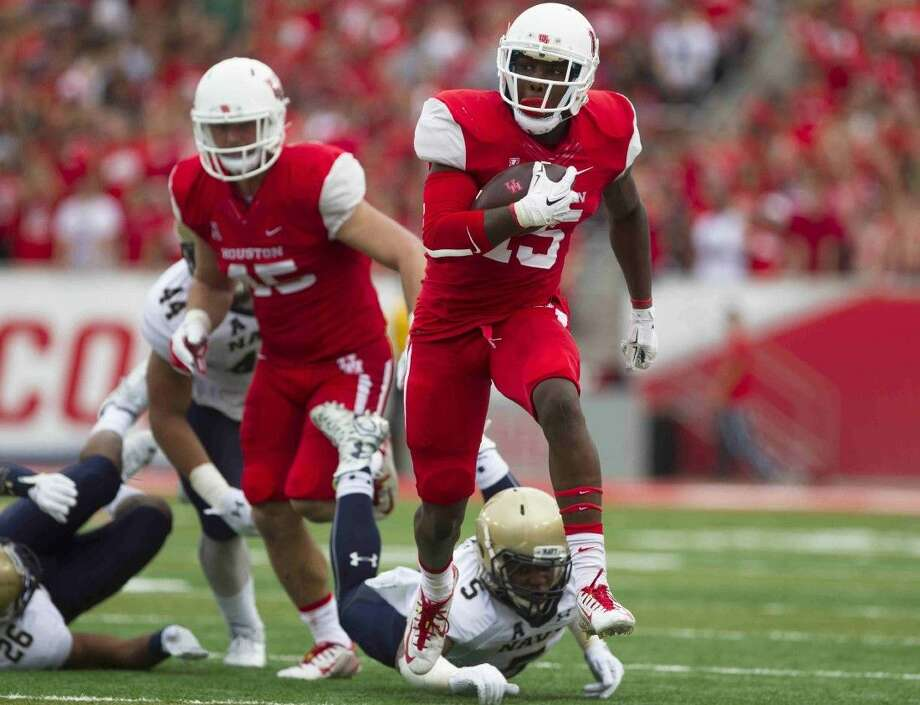 Houston running back Brandon Wilson runs the ball during a college football game at TDECU Stadium Friday, Nov. 27, 2015, in Houston.