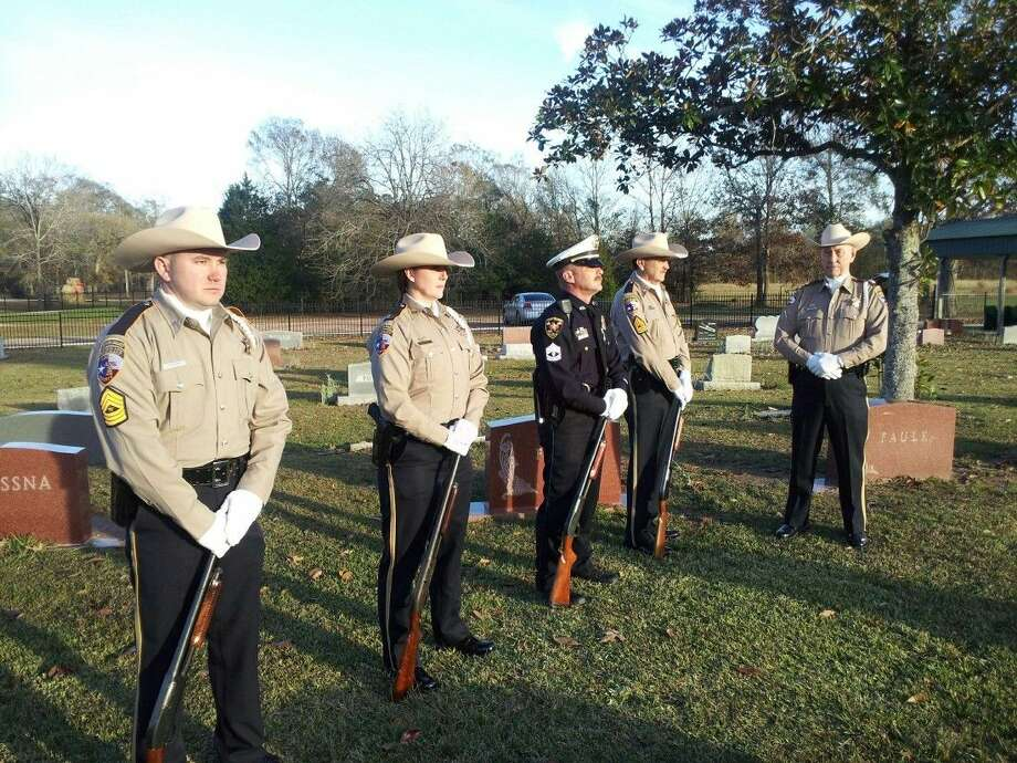 The Liberty County Sheriff's Honor Guard performs a 21-gun salute at the recent funeral of a World War II veteran and father of a sheriff's sergeant. The members of the Honor Guard donate their time to perform such honors. Photo: Submitted