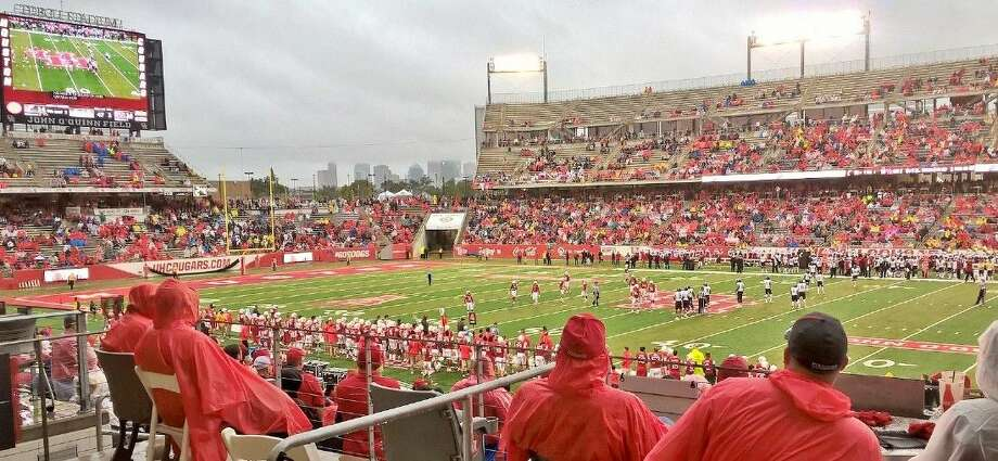 The Houston skyline is seen through the northeast corner of the University of Houston's TDECU Stadium on Saturday as the unbeaten Cougars tangle with AAC rival Cincinnati. The Cougars won 33-30 to remain unbeaten in nine games, including five in the AAC.