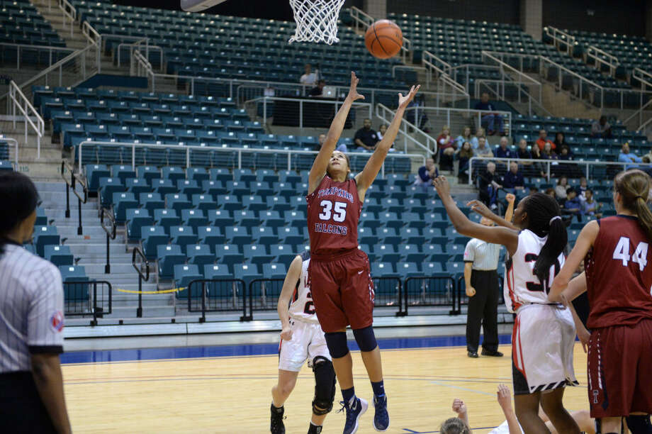 Tompkins' Ivana Okoro pulls in a rebound against Colleyville Heritage during the Phillips 66 Katy Classic girls championship Dec. 5 at the Leonard Merrell Center in Katy. To view or purchase this photo and others like it, visit HCNpics.com. Photo: Craig Moseley