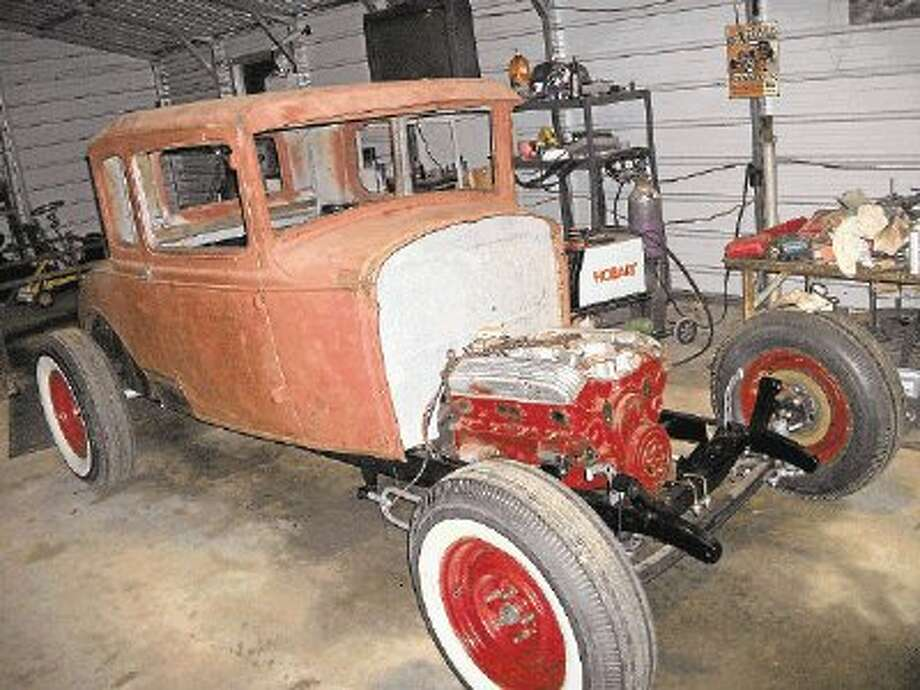 Dan Kiblinger, owner of Dan's Guitars, is rebuilding a 1931 Ford Model A, which he describes as his dream car. Photo: Submitted Photo / @WireImgId=2666340