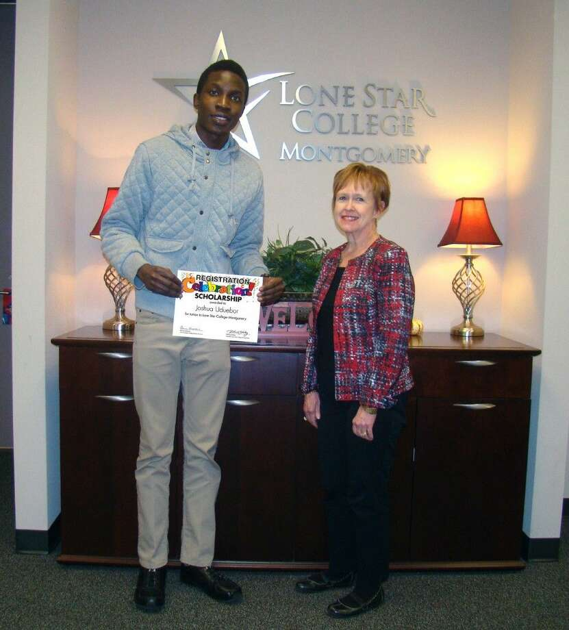 "Lone Star College-Montgomery student Joshua Uduebor, left, is the ""Registration Celebration"" early registration grand prize winner, receiving free tuition for the upcoming spring semester."