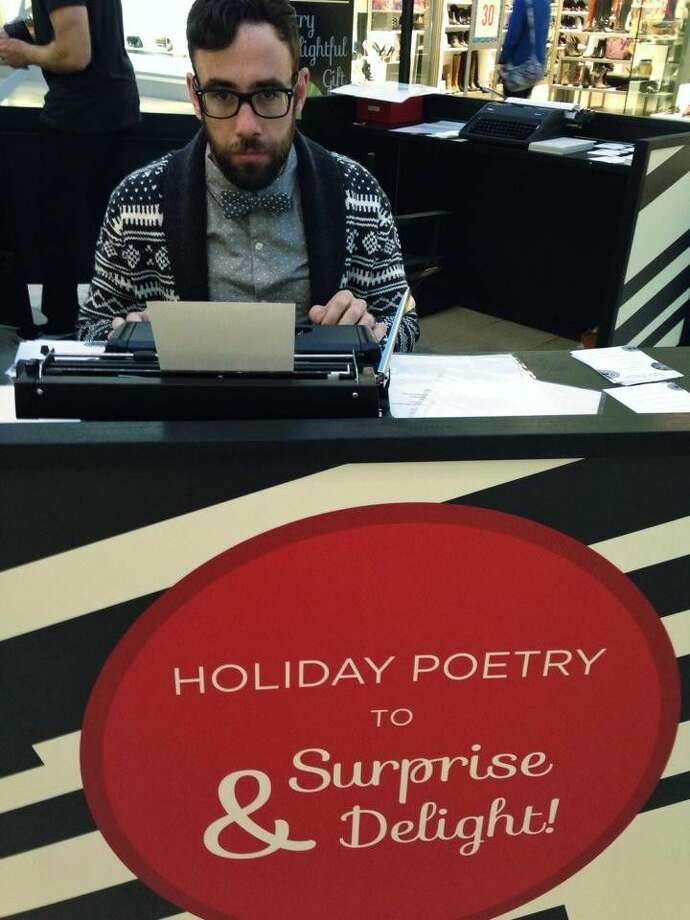 Conor Bracken types a poem for a shopper at The Woodlands Mall on Thursday, Dec. 6 .