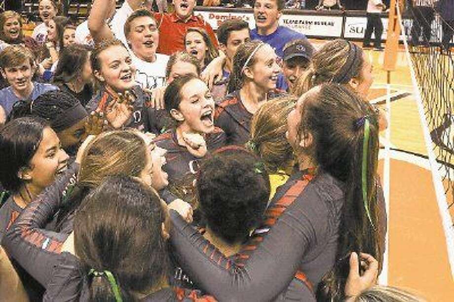 Oak Ridge celebrates its victory over The Woodlands during the high school volleyball game on Saturday at Johnson Coliseum. To view more photos from the game, go to HCNPics.com. Photo: Michael Minasi
