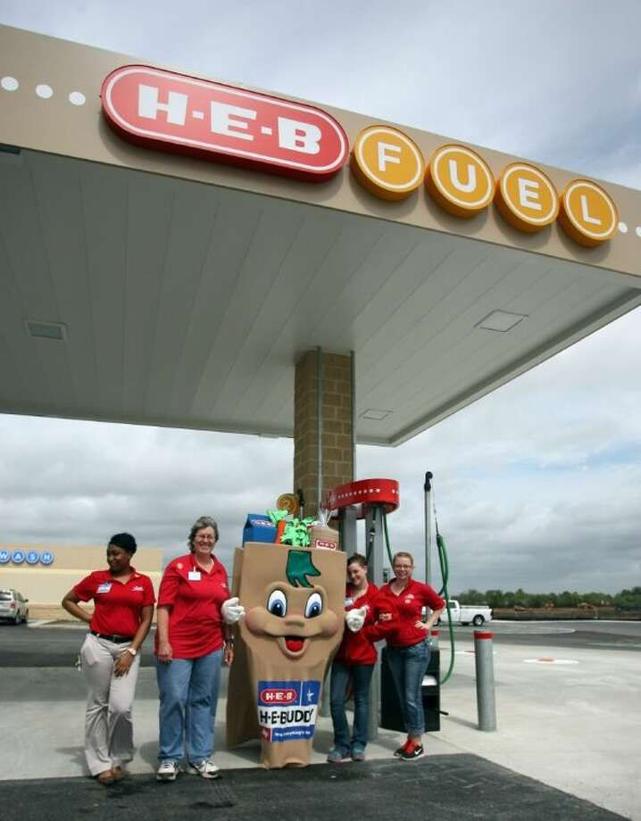 HEB employees and H-E-Buddy welcome customers to the newly opened gas station at 2710 Pearland Parkway Wednesday April 2. Photo: Kar B Hlava