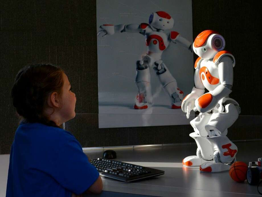 A Klein ISD student interacts with a robot inside the STEAM Express mobile classroom. The STEAM Express will be used to bring age-appropriate interactive hands-on activities and experiments to district campuses and community centers within the school district. Photo: Justin Elbert