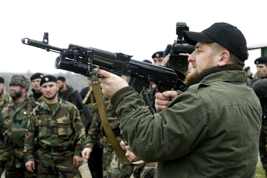 "FILE - Ramzan Kadyrov proudly displays his shooting skills at a firing range in his village of Tsentoroi in front of members of his private army. Officially his army are known as the anti-terrorism squad, but everyone refers to its soldiers as Kadyrovtsy - ""Kadyrov's guys"". Photo: Getty Images"