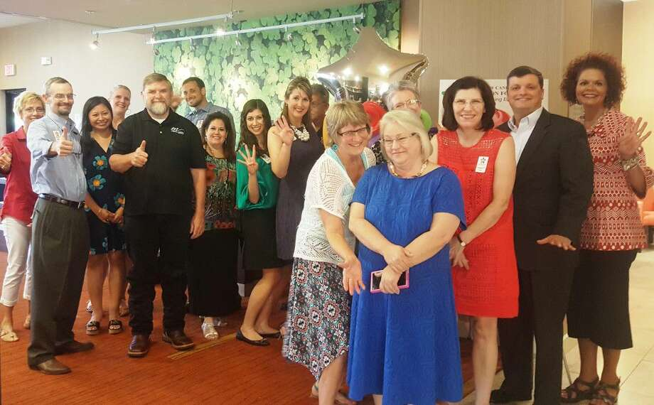 Members and supporters of the New Caney ISD Education Foundation gather to celebrate the foundation's fourth birthday during the New Caney ISD Education Foundation Birthday Bash at the Courtyard Marriott in Kingwood Thursday, July 21.