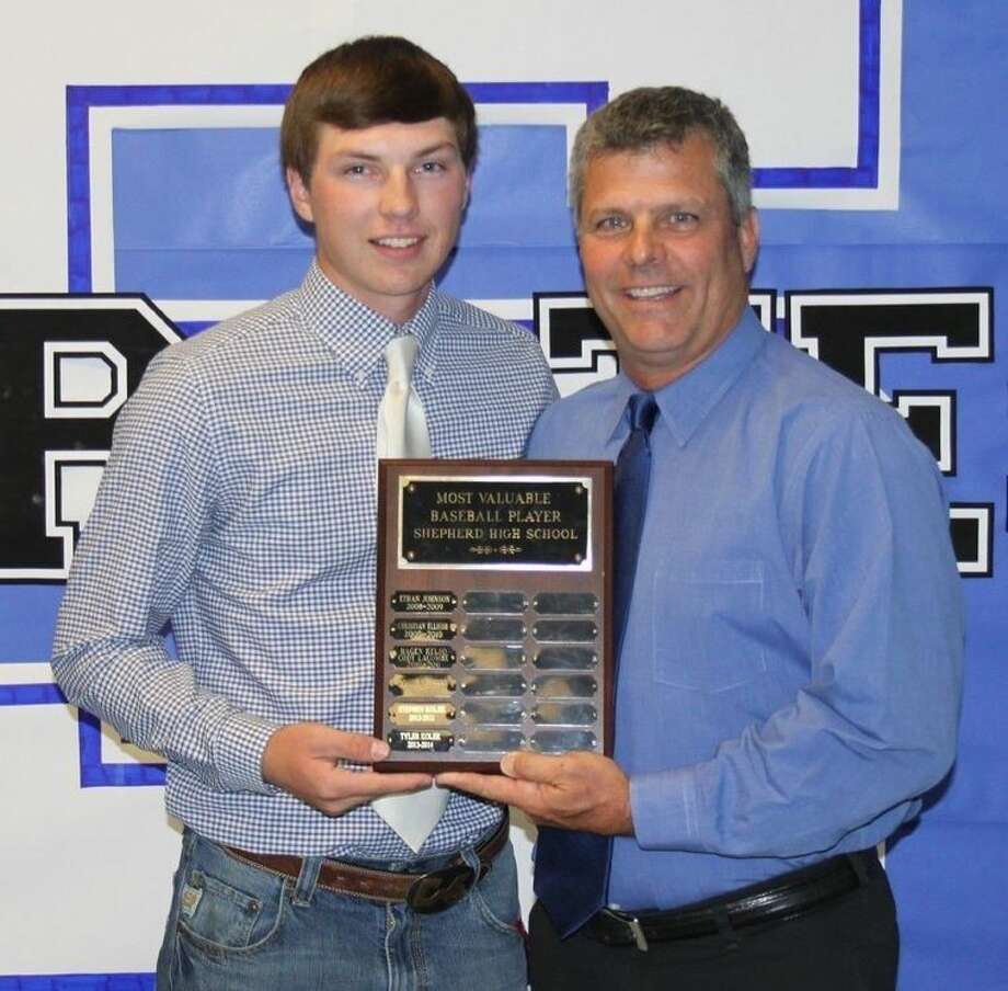 Cody Crowder (left) receives the MVP award from Shepherd Pirates baseball Coach Curtis Fox. Photo: Jacob McAdams