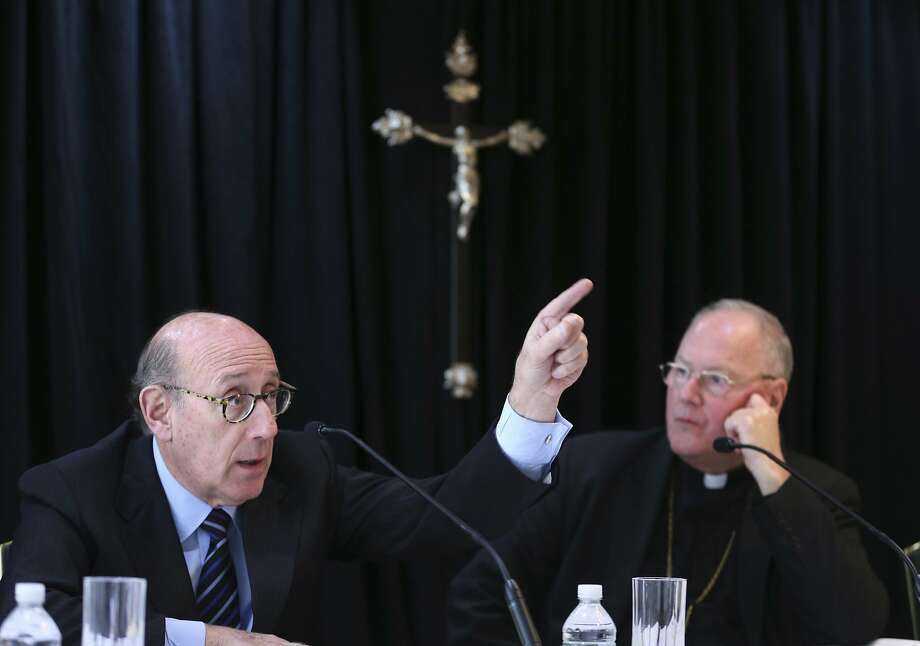 Cardinal Timothy Dolan, Archbishop of New York, right, listens as Kenneth Feinberg speaks to reporters during a news conference in New York, Thursday, Oct. 6, 2016. Dolan helped to announce a new program intended to provide reconciliation and compensation for victims of sexual abuse by clergy; Feinberg will administer the independent program. (AP Photo/Seth Wenig) Photo: Seth Wenig, Associated Press