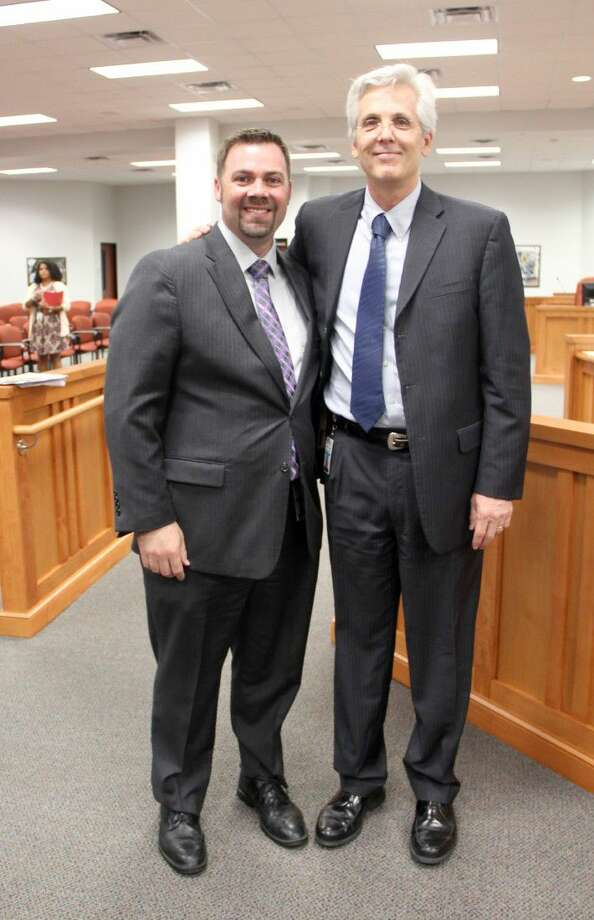 The Pearland ISD Board of Trustees voted to appoint John Palombo to serve as principal of Pearland High School at a special meeting held Tuesday, July 19. Pearland ISD superintendent John Kelly (right) congratulated Palombo (left) after the board meeting. Photo: Kristi Nix