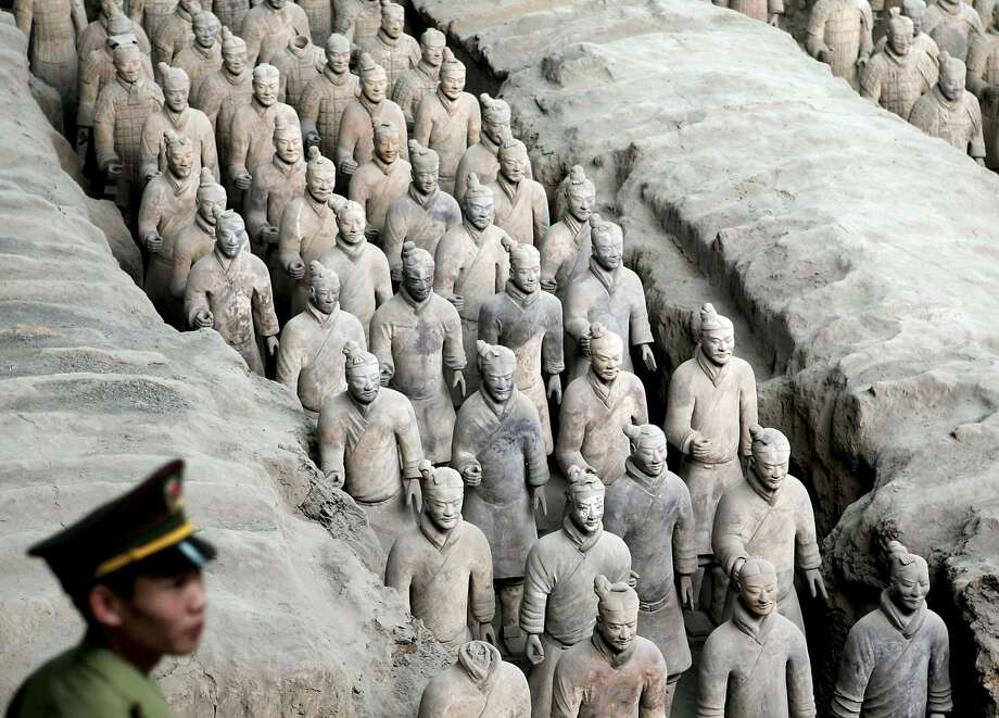 A Chinese paramilitary police officer walks past the excavation site of the Terracotta Warriors in Xian, which was one of the eight ancient capitals of China. Photo: THIERRY ROGE, REUTERS