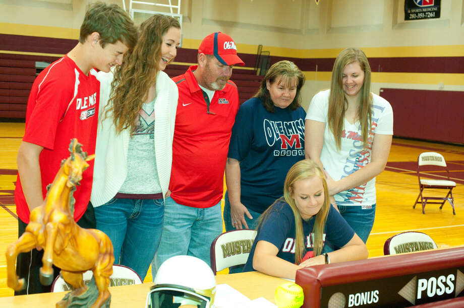 Magnolia West senior Krista Jacobs signs her National Letter of Intent to play softball at Ole Miss. Photo By Tony Gaines