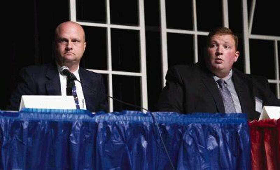 "Incumbent Kenneth ""Rowdy"" Hayden and Harris County Precinct 4 Constable Deputy Tim Hayes, candidates for Precinct 4 Constable, speaks during a forum for various local, state and national races at the Crighton Theatre Wednesday, Dec. 16 in Conroe. Photo: Jason Fochtman"
