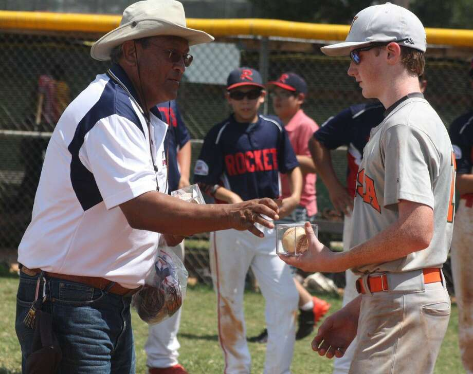 Kyle Chapman League President Dr. Henry Gomez presents Henry Hill his home run ball during ceremonies following Saturday's contest. Photo: Robert Avery