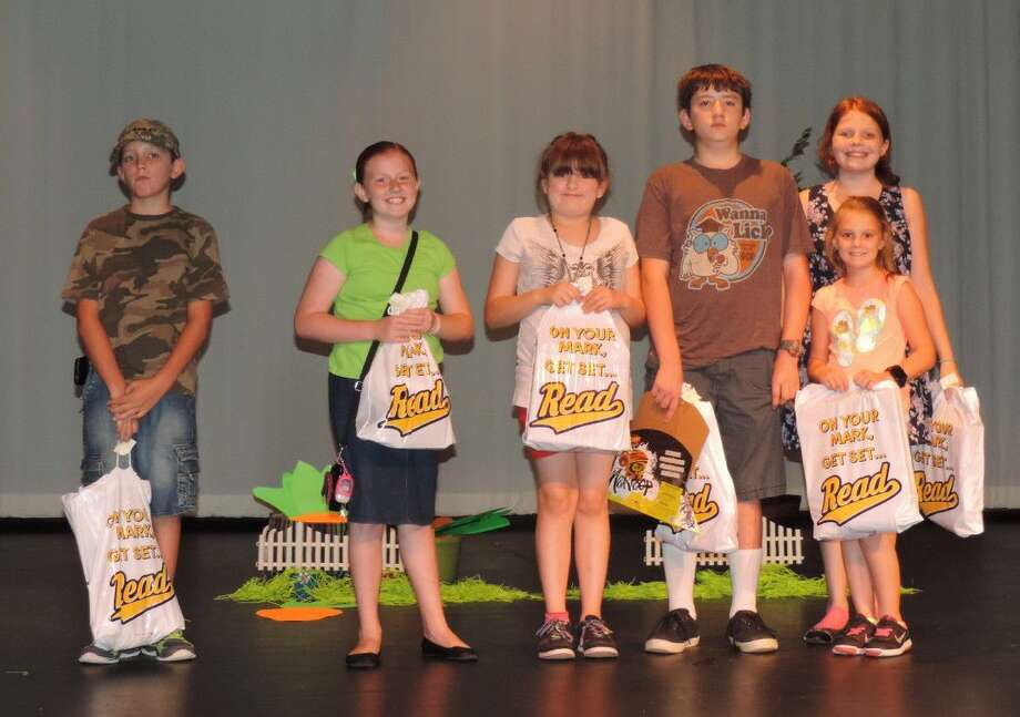 Prize drawing winners in the third to sixth grade group in the Liberty Municipal Library's summer reading program are, left to right, Kamerin Berry, Hannah Sisk, Hannah Hawkins, Cody Hawkins, Lexi Turner (in front) and Samantha McCain (in back).