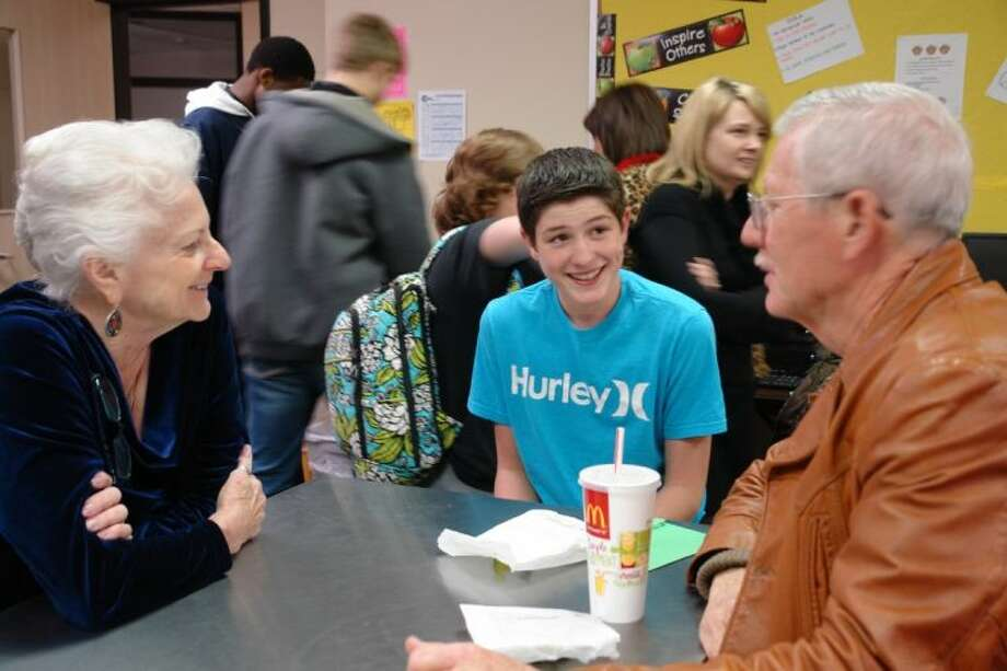 Doris Wilson and Gus Johnson mentor Conroe High ninth-grader Keelan Daniel, 15, each week at lunch. CISD's Project Mentor provides each student in the program with a trusted, consistent adult that deeply cares about their needs, goals, dreams, fears and future.